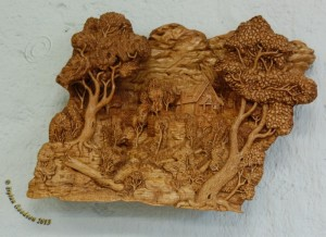 pictorial relief scene of a house built above a wooded canyon carved by dylan goodson
