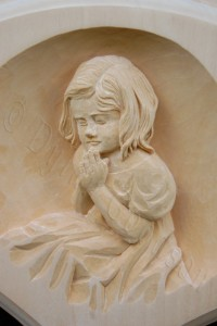 close of one of the relief carvings on the ornate frame