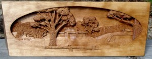 Stove hood with a pictorial relief scene carved on it by dylan goodson